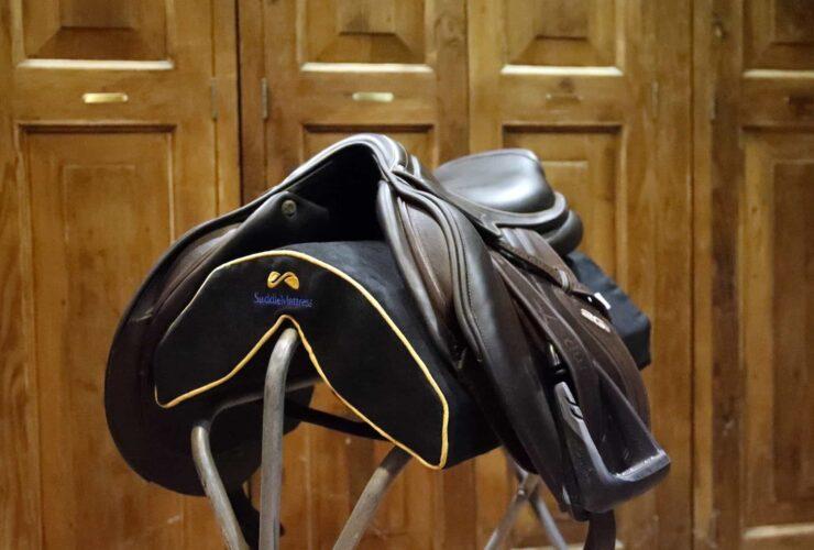 Jumper saddle on SaddleMattress on stand-up saddle rack in tack room.